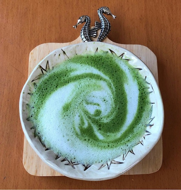 matcha latte with frothed milk