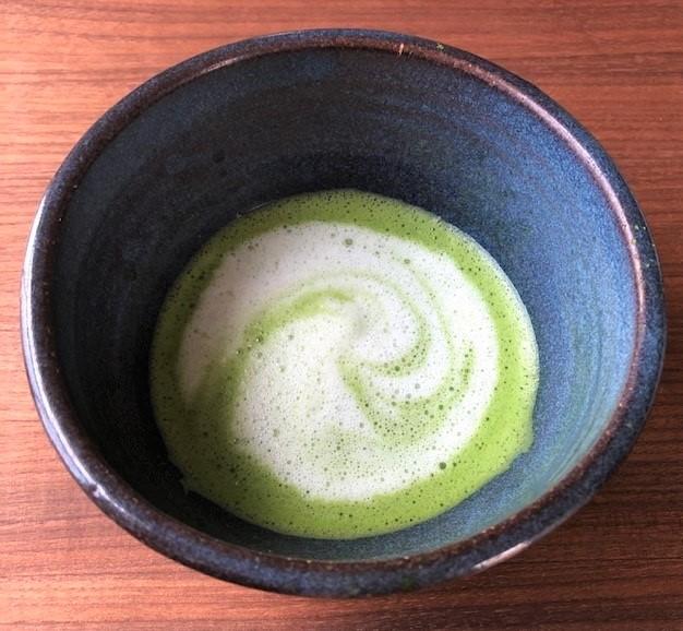 swirled bowl of matcha latte